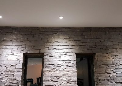 Downlighting a feature wall